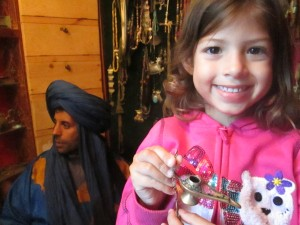 Tina was happy to have the right amount of money for a copper lamp. She negotiated hard with the Berbers in Morocco!